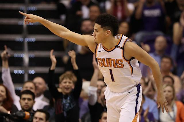 Devin Booker averaged just under 25 points per game last season as the Suns finished with the NBA's worst record (AFP Photo/Christian Petersen)