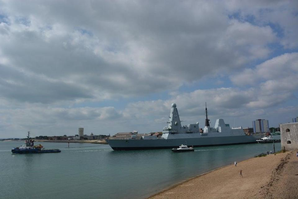 HMS Daring being towed from Portsmouth Naval Base for the multi-million pound engine refit (Ben Mitchell/PA)