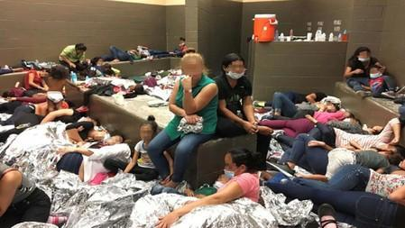 An overcrowded area holding families at a Border Patrol station is seen in Weslaco