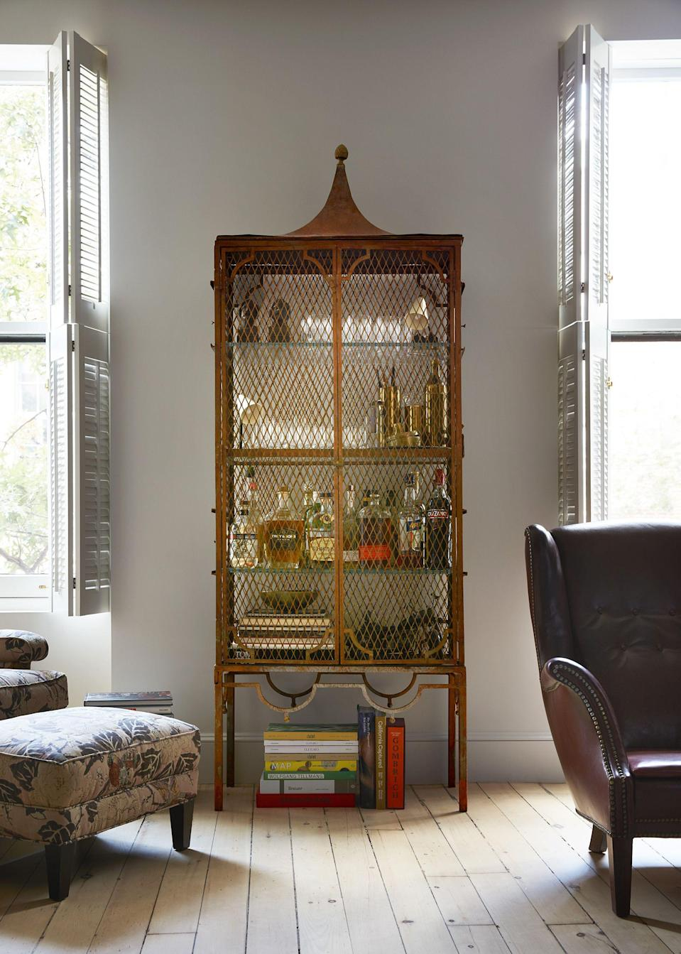 "<p>Bar carts have been all the rage for some time now, but if you really want to get serious on style and storage, bar cabinets are where it's at. Unlike a <a href=""https://www.housebeautiful.com/design-inspiration/a30120705/how-to-style-bar-cart/"" rel=""nofollow noopener"" target=""_blank"" data-ylk=""slk:bar cart"" class=""link rapid-noclick-resp"">bar cart</a>, a bar cabinet gives you the space to store bottles of wine and liquor (and glassware, and bar tools!) behind closed doors so they're not <em>always</em> on display—and since there are tons of statement bar cabinets out there, you can stash away your <a href=""https://www.housebeautiful.com/room-decorating/g1310/home-bar-design-ideas-1012/"" rel=""nofollow noopener"" target=""_blank"" data-ylk=""slk:home bar"" class=""link rapid-noclick-resp"">home bar</a> needs in a piece that stuns all on its own. </p><p>Tall bar cabinets help you take advantage of vertical space, while lower profile options double as a spot to lean art and display objets. They may not be on wheels like bar carts, but you can't say they're not practical! The best part? You'll feel like a character on <em>Mad Men</em> every time you mix up a new drink. Your burgeoning bartending hobby just got so much cooler. </p>"
