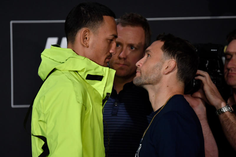 EDMONTON, AB - JULY 25: (L-R) Opponents Max Holloway and Frankie Edgar face off for media during the UFC 240 Ultimate Media Day at Delta Hotels by Marriott Edmonton South Conference Centre on July 25, 2019 in Edmonton, Alberta, Canada. (Photo by Jeff Bottari/Zuffa LLC/Zuffa LLC via Getty Images)
