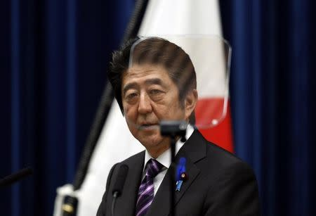 Japan's PM Abe attends a news conference at his official residence in Tokyo