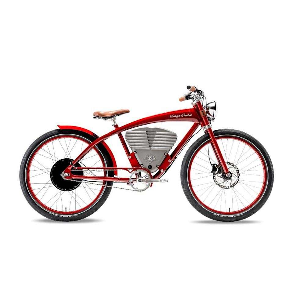 "<p><strong>Price: $4995 • Range: 25–50 mi • Weight: 79 lb</strong></p><p><a class=""link rapid-noclick-resp"" href=""https://www.vintageelectricbikes.com/products/tracker?variant=28672387842123"" rel=""nofollow noopener"" target=""_blank"" data-ylk=""slk:BUY NOW"">BUY NOW</a></p><p>Styled to look like the motorcycles that raced around wood-plank motordromes in the early 1900s, the Vintage Electric Tracker has an LED headlight, a leather seat, and a metal battery case finished to look like the cooling fins of an air-cooled V-twin engine. The Tracker can perform regenerative braking just like a hybrid or electric car, recapturing energy with its 1.0-hp motor to stretch more range from the 0.7-kWh battery. The optional $149 Race mode increases peak output to 4.0 horsepower and top speed from 20 mph to 36 mph.</p>"