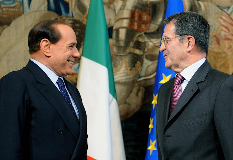 """Outgoing Italian Prime Minister Romano Prodi (R) smiles beside new Prime Minister Silvio Berlusconi during a ceremony at Chigi Palace in Rome on May 8, 2008. Berlusconi followed by each of his 21 ministers delared """"I swear to be faithful to the republic, to respect the constitution and to exercise my duties in the sole interest of the nation,"""" as they took the oath of office as Berlusconi embarked on his third stint as prime minister. AFP PHOTO / Alberto Pizzoli (Photo credit should read ALBERTO PIZZOLI/AFP via Getty Images) (Photo: ALBERTO PIZZOLI via Getty Images)"""