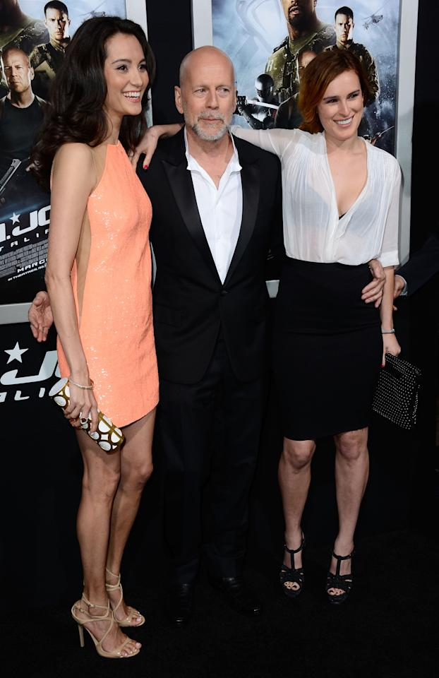 "HOLLYWOOD, CA - MARCH 28:  (L-R) Emma Heming, actor Bruce Willis, Rumer Willis arrive at the Premiere of Paramount Pictures' ""G.I. Joe: Retaliation"" at TCL Chinese Theatre on March 28, 2013 in Hollywood, California.  (Photo by Frazer Harrison/Getty Images)"