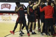 San Diego State's Nathan Mensah (31) and Adam Seiko (2) celebrate after defeating UNLV following an NCAA college basketball game Wednesday, March 3, 2021, in Las Vegas. (AP Photo/Joe Buglewicz)