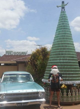 The tree made from more than 2500 beer cans even lights up at night. Photo: Wes Boyd.