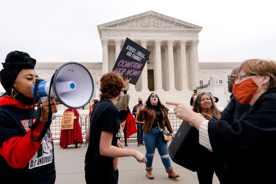 People demonstrate for and against the nomination of Amy Coney Barrett to the Supreme Court, Monday, Oct. 26, 2020, outside the Supreme Court on Capitol Hill in Washington. (AP Photo/Jacquelyn Martin) ORG XMIT: DCJM103