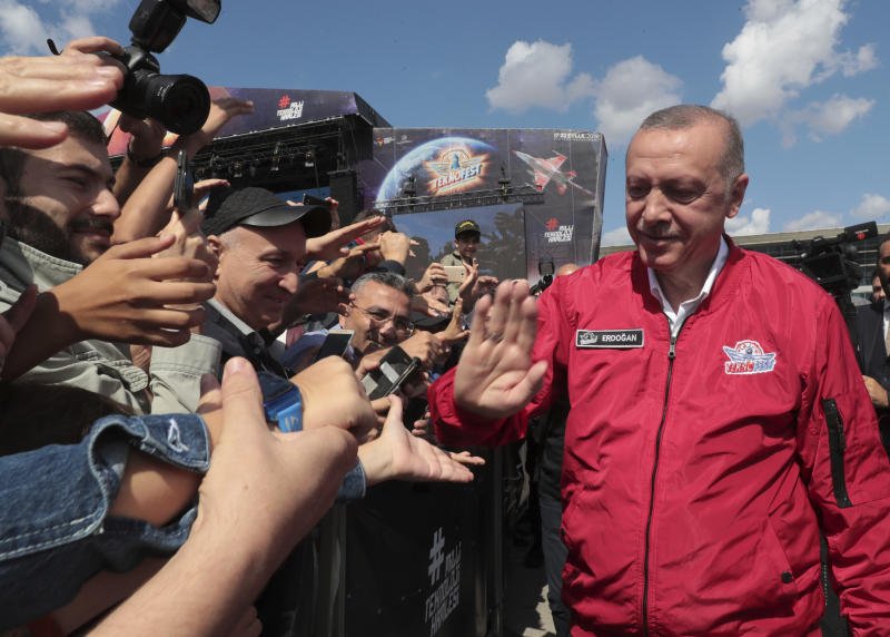 Turkey's President Recep Tayyip Erdogan with his supporters at a technology fair in Istanbul, Saturday, Sept. 21, 2019. Erdogan expressed frustration with what he said was the United States' continued support to Syrian Kurdish forces that Turkey regards as terrorists and reiterated that Turkey had completed all preparations for a possible unilateral military operation in northeast Syria, along the Turkish border east of the Euphrates River.(Presidential Press Service via AP, Pool)