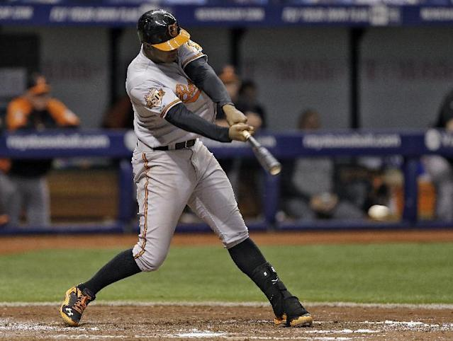 Baltimore Orioles' Jonathan Schoop lines an RBI single off Tampa Bay Rays starting pitcher David Price during the fourth inning of a baseball game Thursday, May 8, 2014, in St. Petersburg, Fla. Orioles' Adam Jones scored on the hit. (AP Photo/Chris O'Meara)