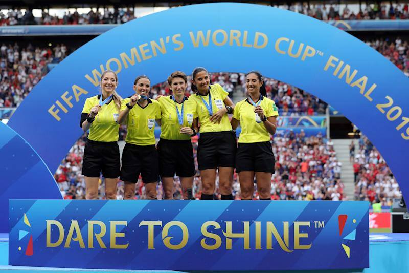 LYON, FRANCE - JULY 07: Match officials pose with their medals after the 2019 FIFA Women's World Cup France Final match between The United States of America and The Netherlands at Stade de Lyon on July 07, 2019 in Lyon, France. (Photo by Elsa/Getty Images)