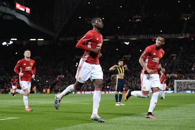 Manchester United's French midfielder Paul Pogba (C) celebrates scoring their first goal from the penalty spot against Fenerbahce at Old Trafford in Manchester, north west England, on October 20, 2016 (AFP Photo/Oli Scarff)