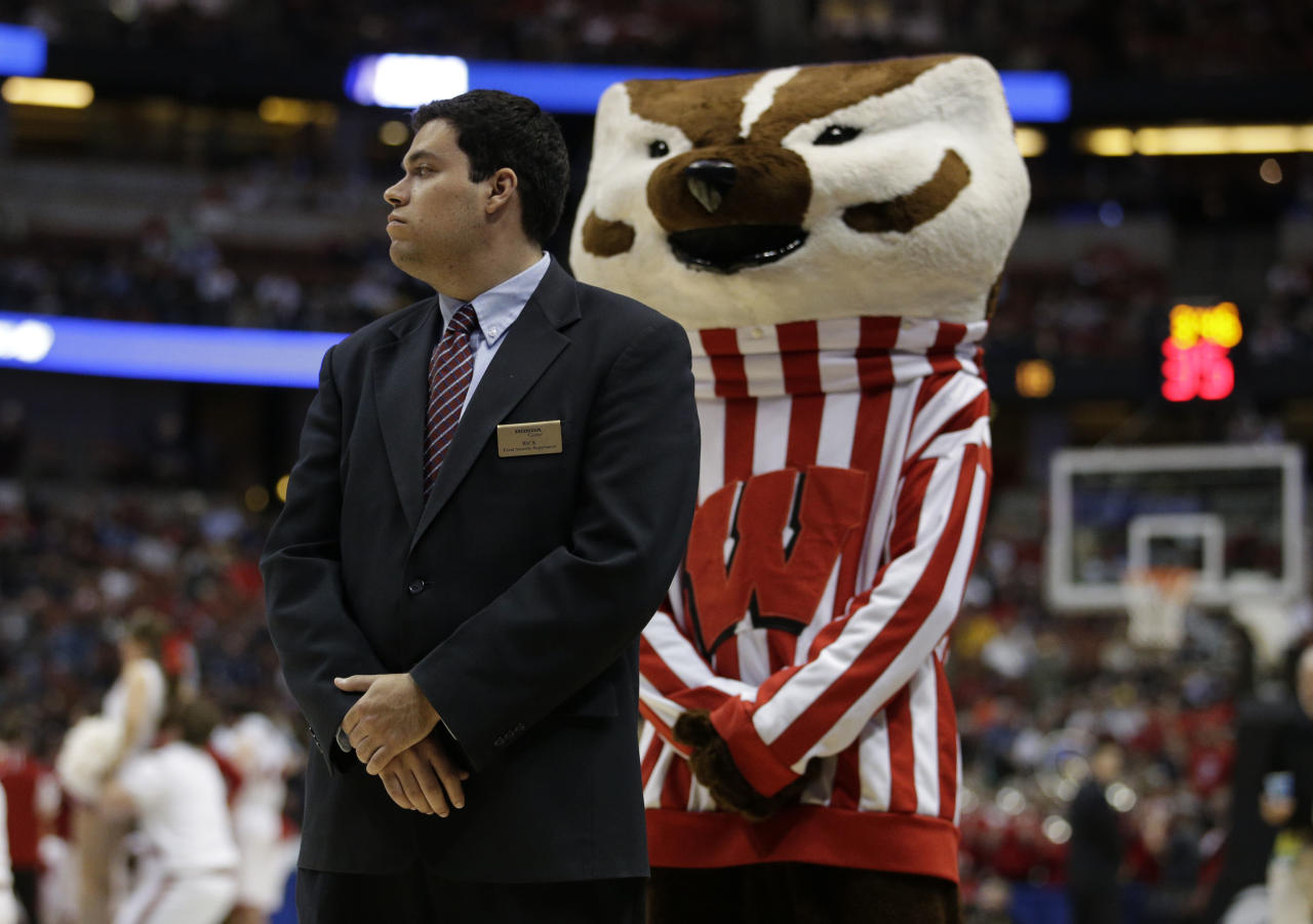The Wisconsin mascot mimics a security guard during a time out during the second half in a regional semifinal NCAA college basketball tournament game against Baylor, Thursday, March 27, 2014, in Anaheim, Calif. Wisconsin won 69-52. (AP Photo/Jae C. Hong)