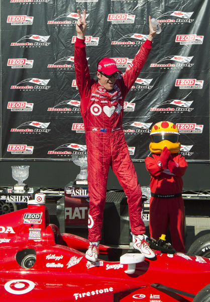 New Zealand's Scott Dixon celebrates after winning the IndyCar auto race in Toronto on Saturday, July 13, 2013. (AP Photo/The Canadian Press, Michelle Siu)