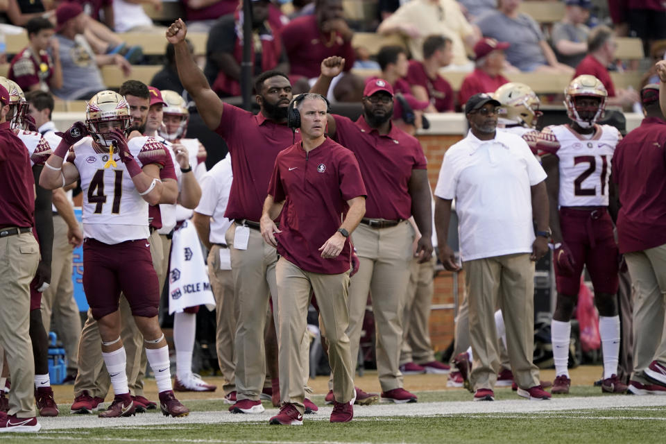 Florida State coach Mike Norvell watches during the second half of the team's NCAA college football game against Wake Forest on Saturday, Sept. 18, 2021, in Winston-Salem, N.C. (AP Photo/Chris Carlson)
