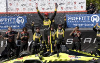 Sebastien Bourdais (18) celebrates after winning the IndyCar Firestone Grand Prix of St. Petersburg, Sunday, March 11, 2018, in St. Petersburg, Fla. (AP Photo/Jason Behnken)