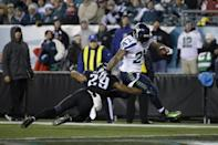 Seattle Seahawks' Marshawn Lynch (24) breaks a tackle by Philadelphia Eagles' Nate Allen (29) to score a touchdown during the second half of an NFL football game, Sunday, Dec. 7, 2014, in Philadelphia. (AP Photo/Matt Rourke)