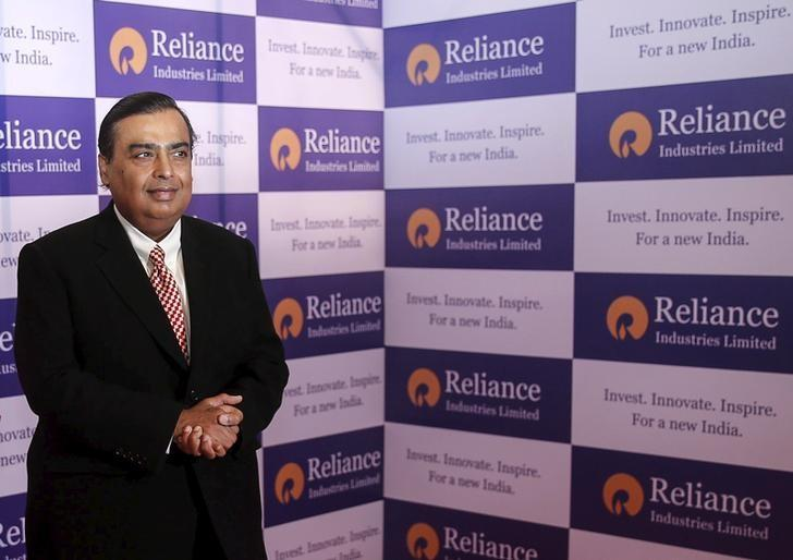 Mukesh Ambani, chairman of Reliance Industries Limited, poses for photographers before addressing the annual shareholders meeting in Mumbai