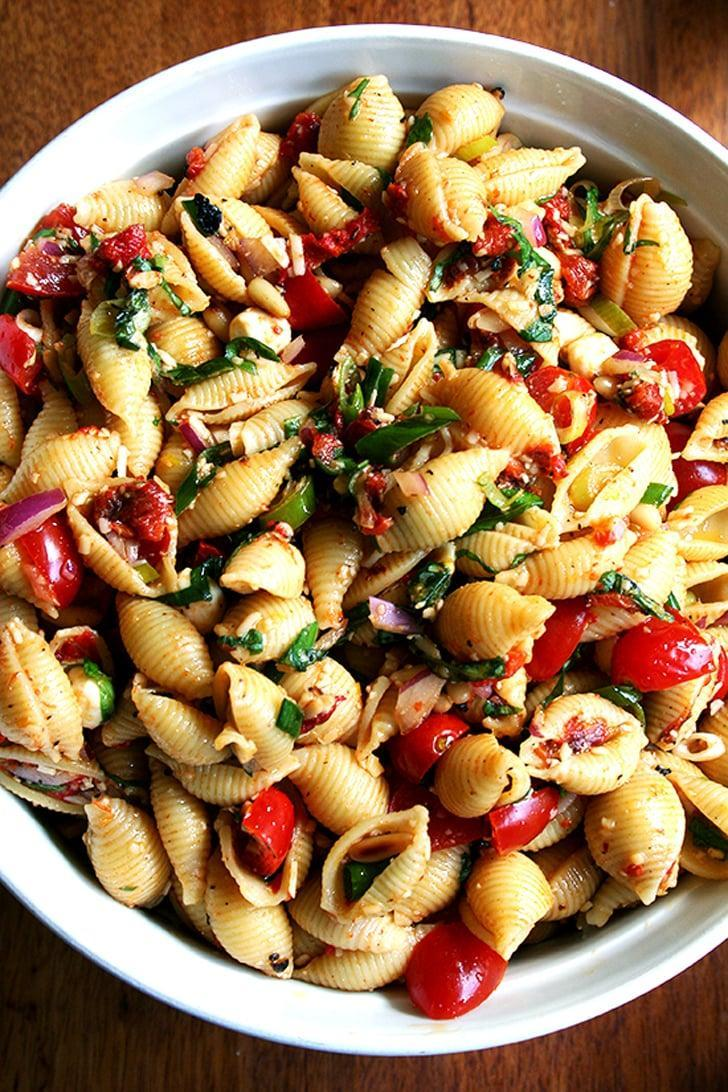 """<p>This pasta salad is particularly good warm, and has the freshest hints of olive oil and lemon juice. The best part about this salad is that you can adjustment the recipe based on your preferences (try feta instead of mozzarella, swap out veggies or add mre, etc.), so you can put a new spin on it every time you make it. </p> <p><strong>Get the recipe</strong>: <a href=""""http://www.alexandracooks.com/2008/01/19/simple-pasta-salad/"""" class=""""link rapid-noclick-resp"""" rel=""""nofollow noopener"""" target=""""_blank"""" data-ylk=""""slk:tomato, scallion, and roasted bell pepper pasta salad"""">tomato, scallion, and roasted bell pepper pasta salad</a></p>"""