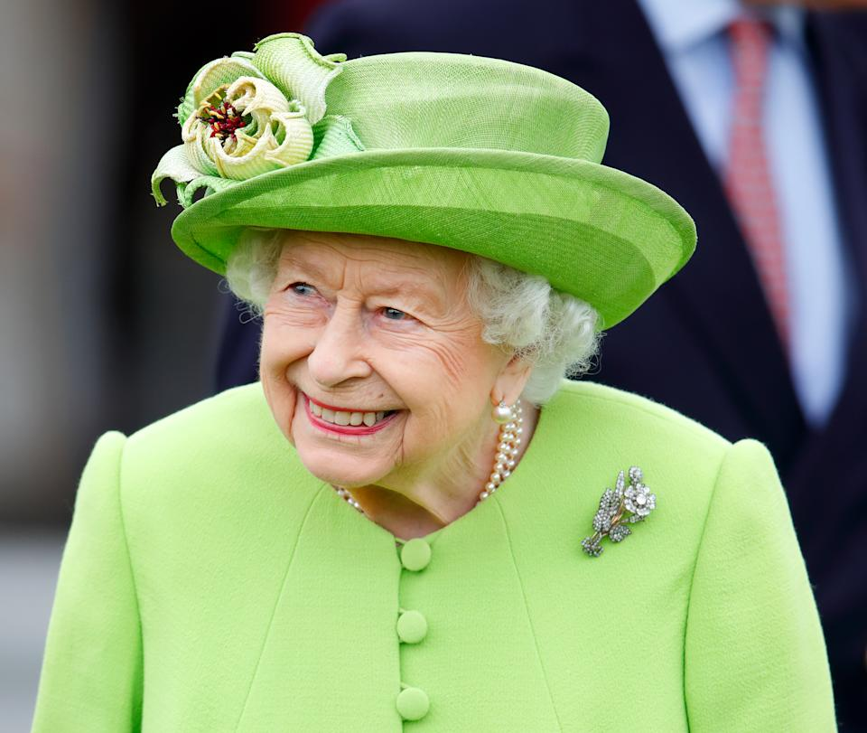 EGHAM, UNITED KINGDOM - JULY 11: (EMBARGOED FOR PUBLICATION IN UK NEWSPAPERS UNTIL 24 HOURS AFTER CREATE DATE AND TIME) Queen Elizabeth II (wearing her Vanguard Rose Brooch which she received in 1944 from Messrs John Brown and Co. when she launched HMS Vanguard) attends the Out-Sourcing Inc. Royal Windsor Cup polo match and a carriage driving display by the British Driving Society at Guards Polo Club, Smith's Lawn on July 11, 2021 in Egham, England. (Photo by Max Mumby/Indigo/Getty Images)