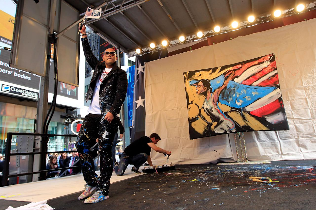 NEW YORK, NY - APRIL 18:  Performance artist David Garibaldi performs his art on stage during the Team USA Road to London 100 Days Out Celebration in Times Square on April 18, 2012 in New York City.  (Photo by Chris Trotman/Getty Images for USOC)