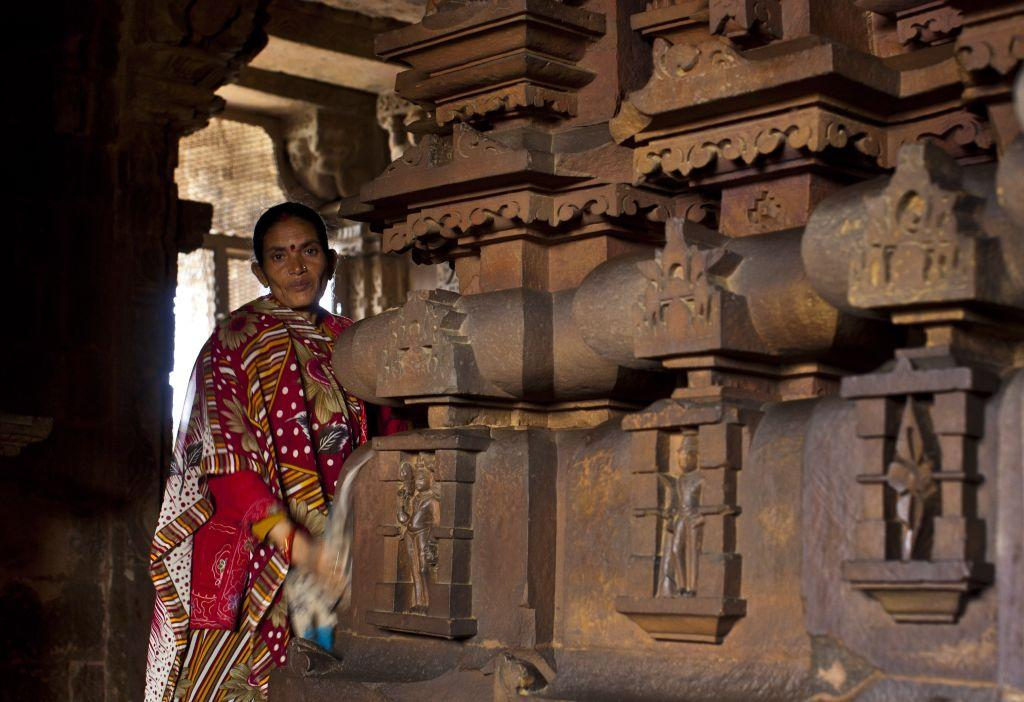 An woman worker cleans the temple precincts in Khajuraho.
