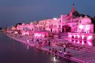 Temples and other buildings on the bank of Sarayu river are seen illuminated ahead of the foundation-laying ceremony for a Hindu temple in Ayodhya