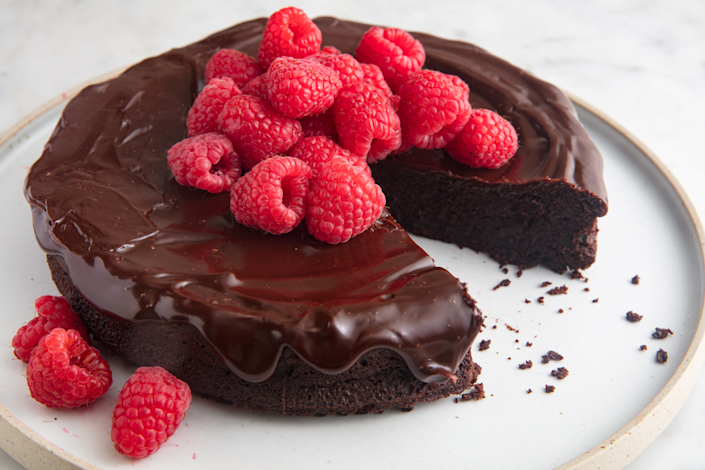 """<p>All chocolate everything...and a handful of berries for good measure.</p><p>Get the recipe from <a href=""""https://www.delish.com/cooking/recipe-ideas/a19473626/best-flourless-chocolate-cake-recipe/"""" rel=""""nofollow noopener"""" target=""""_blank"""" data-ylk=""""slk:Delish"""" class=""""link rapid-noclick-resp"""">Delish</a>.</p>"""