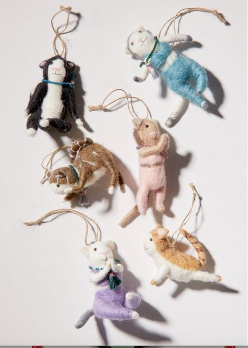 "Cats doing yoga! Enough said. Get it <a href=""https://www.urbanoutfitters.com/en-ca/shop/yoga-cat-christmas-ornament"" target=""_blank"" rel=""noopener noreferrer"">at Urban Outfitters</a> for $20."