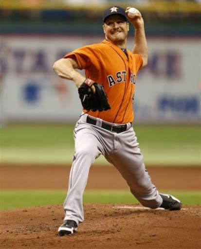 Houston Astros starting pitcher Erik Bedard throws during the first inning of a baseball game against the Tampa Bay Rays, Sunday, July 14, 2013, in St. Petersburg, Fla. (AP Photo/Mike Carlson)
