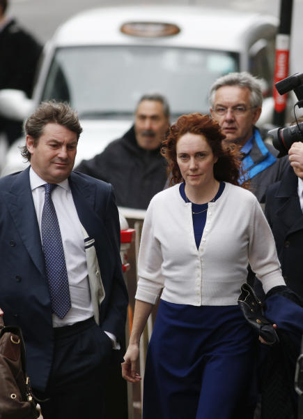 Rebekah Brooks, right, former News International chief executive, and her husband Charlie Brooks, left, arrive at the Central Criminal Court in London where she appears to face charges related to phone hacking, Thursday, Feb. 20, 2014. (AP Photo/Lefteris Pitarakis)