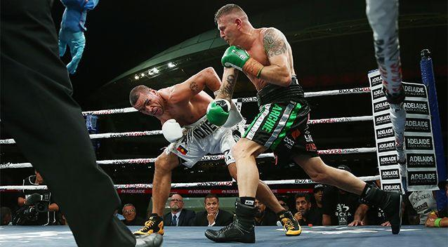 Anthony Mundine moves to evade a right from the eventual winner of the fight, Danny Green. Photo: Getty Images