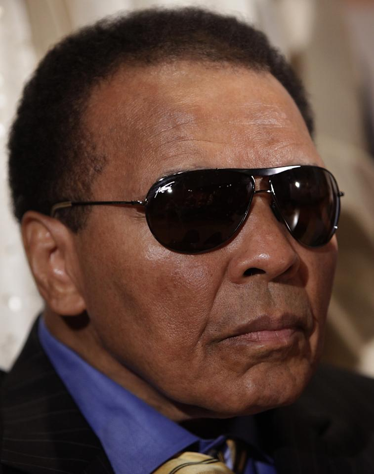 World Heavyweight Boxing Champion Muhammad Ali attends a news conference at the National Press Club on May 24, 2011 in Washington, DC. Ali and other prominent American Muslims and clergy appealed to Iran's Supreme Leader for the release Shane Bauer and Josh Fattal, the two US hikers detained in Iran since July 31, 2009. AFP PHOTO/YURI GRIPAS (AFP Photo/YURI GRIPAS)