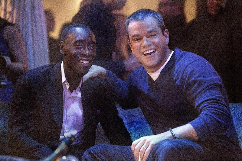 "This publicity photo released by Showtime shows Don Cheadle, left, as Marty Kaan and Matt Damon, as himself, in ""House of Lies,"" Season 2, Episode 4, on Showtime. Damon is practically becoming a TV comedy regular. Showtime said Damon will guest star next week on ""House of Lies,"" playing what the channel called a ""maniacal megastar"" version of himself. (AP Photo/Showtime, Michael Desmond)"
