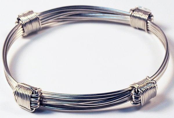 4 knot sterling silver bracelet in elephant hair style