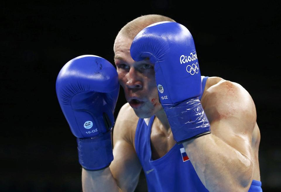 2016 Rio Olympics - Boxing - Preliminary - Men's Bantam (56kg) Round of 16 Bout 178 - Riocentro - Pavilion 6 - Rio de Janeiro, Brazil - 14/08/2016. Vladimir Nikitin (RUS) of Russia competes. REUTERS/Peter Cziborra FOR EDITORIAL USE ONLY. NOT FOR SALE FOR MARKETING OR ADVERTISING CAMPAIGNS.