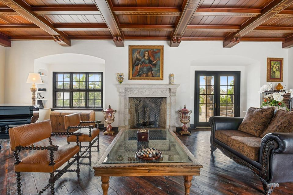 <p>Original inlaid wooden floors are the highlight of spacious living room, though the elaborate coffered ceiling is certainly a close second.</p>