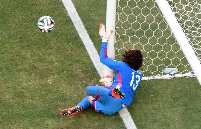 Mexico's goalkeeper Guillermo Ochoa makes a save during the group A World Cup soccer match between Brazil and Mexico at the Arena Castelao in Fortaleza, Brazil, Tuesday, June 17, 2014. (AP Photo/Francois Xavier Marit, pool)