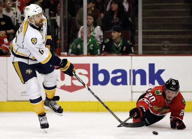 Nashville Predators' Shea Weber (6), left, passes against Chicago Blackhawks' Brandon Saad (20) during the first period of an NHL hockey game in Chicago, Friday, March 14, 2014. (AP Photo/Nam Y. Huh)