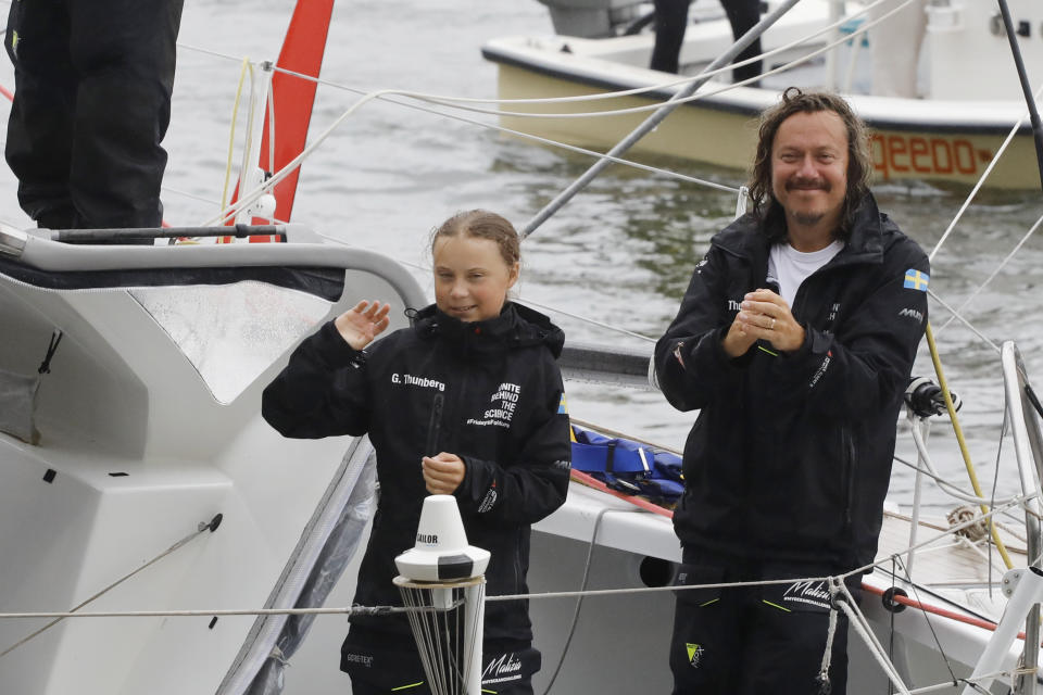Greta Thunberg, a 16-year-old Swedish environmental activist, stands with her father Sventa Thunberg after arriving in New York harbor aboard the Malizia II, Wednesday, Aug. 28, 2019. The zero-emissions yacht left Plymouth, England on August 14. Thunberg is scheduled to address the United Nations Climate Action Summit on Sept. 23. (AP Photo/Mark Lennihan)