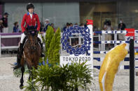 United States' Jessica Springsteen, riding Don Juan van de Donkhoeve, enters the arena to compete during the equestrian jumping individual competition during the 2020 Summer Olympics, Tuesday, Aug. 3, 2021, in Tokyo, Japan. (AP Photo/Carolyn Kaster)