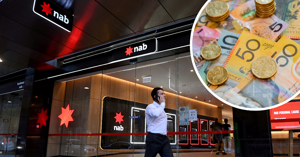 A man walks past a NAB branch holding a phone to his ear. Australian cash and coins in a bubble in the top right corner.