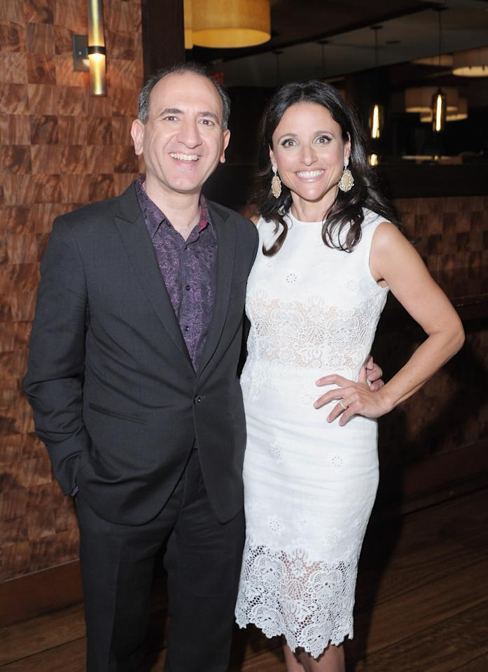 "NEW YORK, NY - APRIL 10:  Creator/Executive Producer Armando Ianucci and actress Julia-Louis Dreyfus attends the after party for the ""Veep"" screening at Porter House on April 10, 2012 in New York City.  (Photo by Michael Loccisano/Getty Images)"