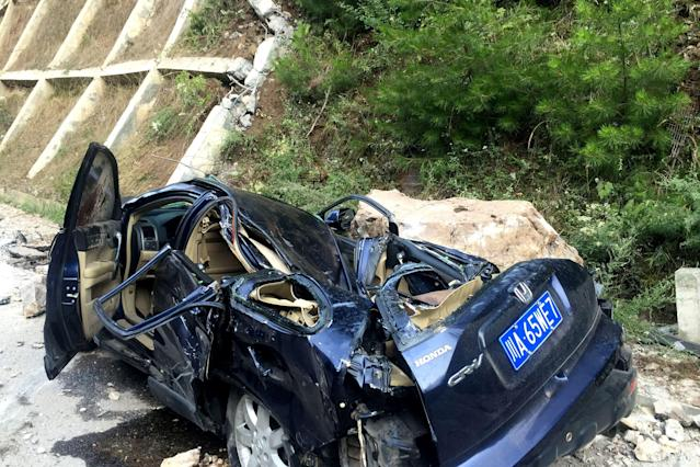<p>A car damaged during an earthquake is seen in Jiuzhaigou in China's southwestern Sichuan province on Aug. 9, 2017. (Photo: STR/AFP/Getty Images) </p>