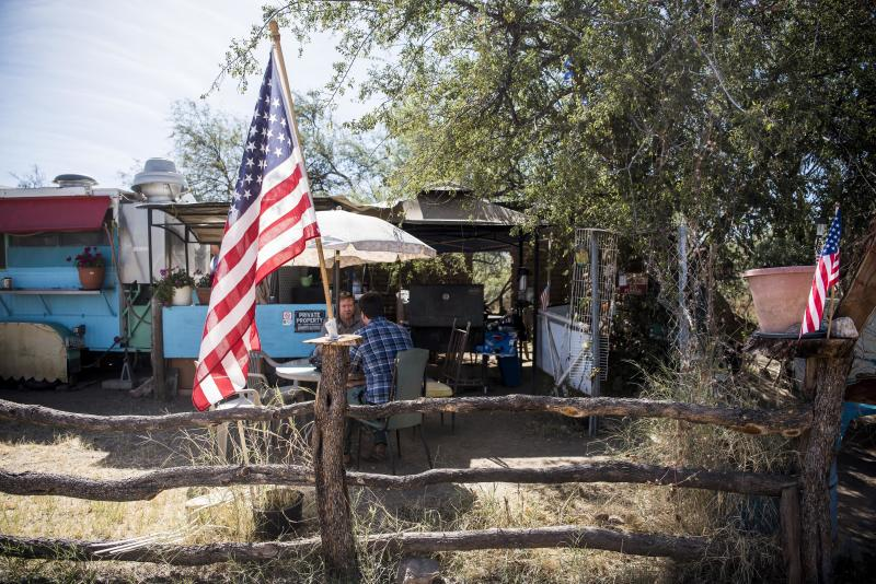 "An American flag sits in front of the ""La Rancherita"" restaurant in Arivaca, Arizona. Some residents of the small town want to do everything they can to help people who are crossing the border. But not everyone agrees with that effort. (Damon Dahlen/HuffPost)"