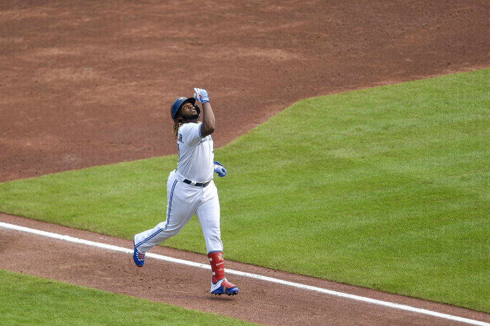 Toronto Blue Jays' Vladimir Guerrero Jr. rounds the bases after hitting a solo home run against the Texas Rangers during the second inning of the second baseball game of a doubleheader in Buffalo, N.Y., Sunday, July 18, 2021. (AP Photo/Adrian Kraus)