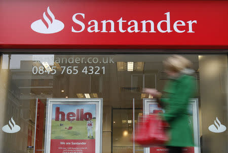 A pedestrian walks past a branch of a Santander bank in London