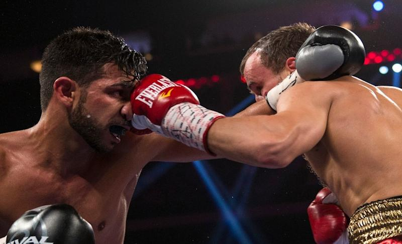 Billy Dib (L) had lost the IBF featherweight world title to Russia's Evgeny Gradovich (R) in 2013