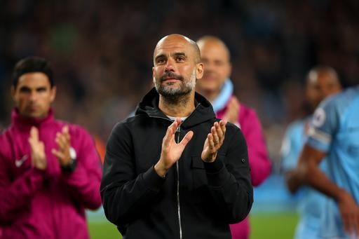 MANCHESTER, ENGLAND - MAY 09: Pep Guardiola the head coach / manager of Manchester City during the Premier League match between Manchester City and Brighton and Hove Albion at Etihad Stadium on May 9, 2018 in Manchester, England. (Photo by Robbie Jay Barratt - AMA/Getty Images)