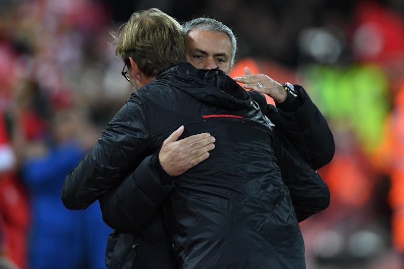Liverpool's manager Jurgen Klopp greets Manchester United's manager Jose Mourinho (R) ahead of the English Premier League football match October 17, 2016 (AFP Photo/Paul ELLIS)